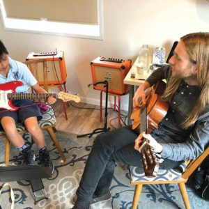 Fifth-grader Lily Roseme took a guitar lesson with Maxwell Gualtieri, one of the school's instructors, on a recent Tuesday afternoon. (photo by Luke Harold)