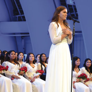 """Immaculate Heart graduates look on as class speaker Danielle Dosch gave a heartfelt message to her graduating class and encourged them to """"rise to the challenges of our generation."""" (photo courtesy of Immaculate Heart)"""