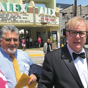 Gay Men's Chorus of Los Angeles Executive Director Jonathan Weedman (right) helped patrons evacuate after a bomb threat was phoned in at the Alex Theatre during a concert on June 23. State Sen. Anthony Portantino also attended the concert. (photo courtesy of the Gay Men's Chorus of Los Angeles)