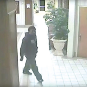 Investigators released a security camera photograph of the suspect entering the apartment building lobby in Hollywood in 2016. (photo courtesy of the LAPD)