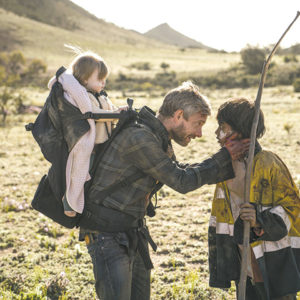 "Andy (Martin Freeman) becomes a father figure to Thoomi (Simone Landers) in ""Cargo,"" a zombie thriller set in Australia. (photo courtesy of Netflix)"
