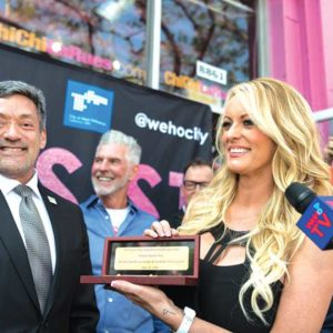 Mayor John Duran (left) gave Stormy Daniels the key to the city on May 23, but a group of residents at the June 4 council meeting didn't think it was appropriate. (photo courtesy of the city of West Hollywood)