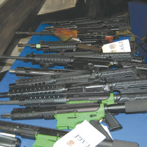 Law enforcement officials displayed numerous rifles that were assembled from parts. Known as ghost guns, the firearms do not have serial numbers and are untraceable. (photo by Edwin Folven)