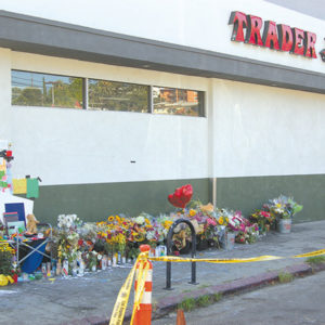People have left candles, flowers and notes at a memorial for store manager Melyda Corado outside the Trader Joe's supermarket. (photo by Edwin Folven)
