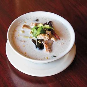 Tom Kha Gai, or coconut chicken soup, is a classic favorite at Chao Krung. (photo courtesy of Chao Krung)