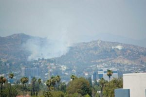 A large plume of smoke could be seen above the Hollywood Hills on July 10 after a fire erupted northwest of the Griffith Observatory. (photo by Edwin Folven)