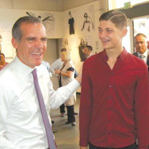 Mayor Eric Garcetti joined 19-year-old Travis Crown at the Los Angeles LGBT Center on July 9 to raise awareness about the HIRE LA's Youth program. Crown, who was formerly homeless, secured an internship through the program that led to a permanent job. (photo by Edwin Folven)