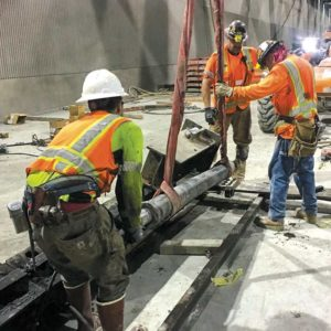 Crews recently installed a hydraulic jack onto the tunnel boring machine track system for the Purple Line Extension project. (photo courtesy of Metro)