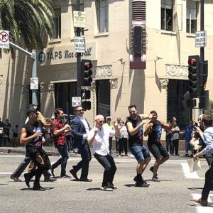 "Councilman Mitch O'Farrell, Hollywood Pantages General Manager Jeff Loeb and the cast of ""On Your Feet"" danced across the new scramble crosswalk at Hollywood Boulevard and Vine Street last week. (photo by Luke Harold)"