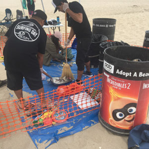 Right, Angel City Brewery and Surfrider Foundation's cleanups were held earlier this summer at Laguna Beach, Huntington Beach, Santa Monica State Beach and Ventura Beach, among other locations. (photo courtesy of  Zapwater Communications, Inc.)