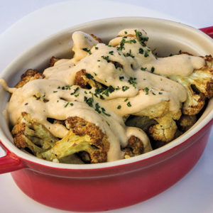 Roasted cauliflower with tahini sauce evokes flavors of Tunisia. (photo courtesy of Harissa)