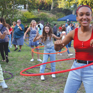 Immaculate Heart Middle School students, including eighth grader Noah Johnson (right), showed their hula hoop skills at the luau. (photo by Callie Webb/Immaculate Heart)