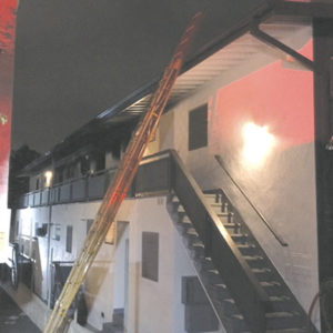 Sheriff's deputies helped residents evacuate from the building on Clark Street. The fire was determined to be accidental. (photo courtesy of the LASD)