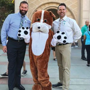 Beverly Vista Principal Chris Regan and Vice Principal Craig Bugbee welcomed students with the school's bulldog mascot. (photo courtesy of the Beverly Hills Unified School District)