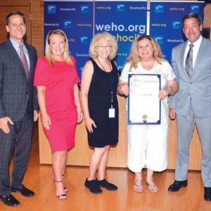 (From left) West Hollywood council members John D'Amico, Lindsey Horvath, Ed's owner Ada Blumstein and West Hollywood Mayor John Duran celebrated the restaurant's legacy. (photo courtesy of the city of West Hollywood)