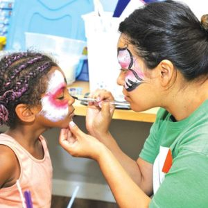 Face-painting, backpacks with school supplies, haircuts and manicures were on the agenda at Imagine L.A.'s back to school event. (photo courtesy of Imagine L.A.)