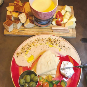 The cheese fondue and Mediterranean plate are great appetizers to cozy up to. (photo by Jill Weinlein)