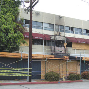 A fire damaged the front of a vacant building on Melrose Avenue just east of Doheny Drive in West Hollywood. (photo by Edwin Folven)