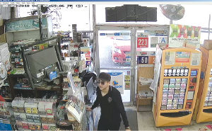 Police released a security camera image from one of the robberies. (photo courtesy of the LAPD)