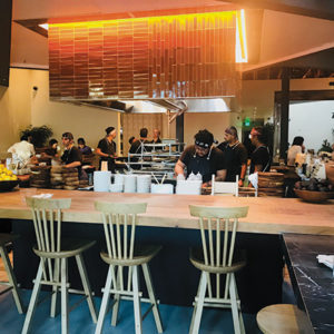 The horseshoe shaped bar sourrounds the open kitchen at Inko Nito, inviting diners to get a bird's eye view of the chefs firing up the grill. (photo by Jill Weinlein)