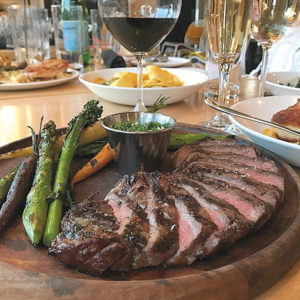 Prime rib-eye steak with herb béarnaise and roasted vegetables. (photo courtesy of Commerson)