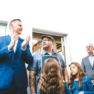Covenant House California CEO Bill Bedrossian (left) and Councilman Mitch O'Farrell (right) celebrated Precise Barbershop and College's grand opening on Sept. 6 with founder Gabe Torres (center) and his twin daughters. (photo courtesy of Precise Barbershop)