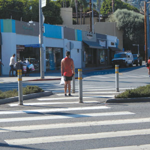 The city of West Hollywood has installed new signals at multiple intersections along Santa Monica Boulevard to improve safety, including at Palm Avenue. (photo by Edwin Folven)