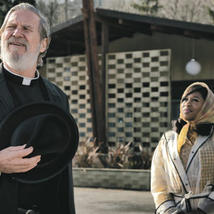 """Jeff Bridges, as Father Flynn, and Cynthia Erivo, as Darlene Sweet, have excellent chemistry in Drew Goddard's """"Bad Times at the El Royale."""" (photo courtesy of 20th Century Fox)"""