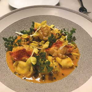 Wally's artistically beautiful dishes include corn agnolotti with poached lobster. (photo by Jill Weinlein)