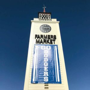 It's time for Dodger baseball! Even the Original Farmers Market Clock Tower bleeds blue as the Dodgers face the Red Sox in the World Series. (photo courtesy of the Original Farmers Market)