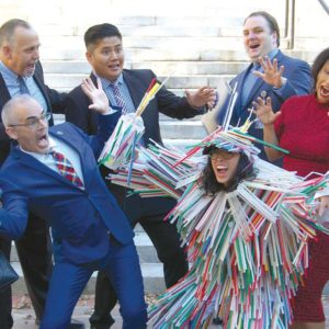 "Council members Mitch O'Farrell (front left) and Nury Martinez joined city staff with Heal the Bay's ""Mon-straws-ity,"" a costumed character that illustrates the dangers single-use plastic straws pose to the environment. (photo by Edwin Folven)"