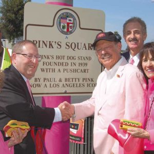 City Councilmen Paul Koretz (fourth from left) joined Pink's Hot Dogs' owners Beverly (left), Richard and Gloria Pink to designate the intersection of Melrose and La Brea avenues as Pink's Square on Sept. 27. Joining them was Councilman David Ryu (left), 4th District, and Los Angeles City Attorney Mike Feuer. (photo by Edwin Folven)