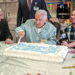 Longtime hospital volunteer Charles Selarz enjoyed a cake with his son Murray and grandson Daniel at Cedars-Sinai Medical Center. (photo courtesy of Cedars-Sinai Medical Center)