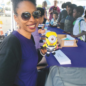 LAUSD counselor Jaza Williams gave hundreds of homeless students toys along with school uniforms and supplies at the annual Day of Giving event at Universal Studios. (photo by Jill Weinlein)
