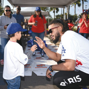 Los Angeles Dodgers pitcher Kenley Jansen helped distribute Thanksgiving dinners to families in need during an annual event at Dodger Stadium. (photo by Jon SooHoo/L.A. Dodgers)