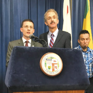 Matthew DeCarolis (left), of the Bet Tzedek Employment Rights Project, and City Attorney Mike Feuer outlined a settlement in a lawsuit filed against two car washes for labor law violations.  (photo courtesy of the Los Angeles City Attorney's Office)