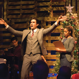 "The Wallis production of ""Love Actually Live"" combines immersive scenery and video screens to bring the classic holiday movie and its soundtrack to life. (photo by Rob Labou)"