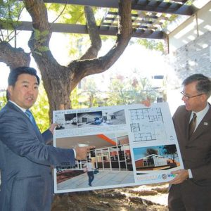 Councilman David Ryu (left) joined City Engineer Gary Lee Moore on a patio that will be preserved in the new bridge housing shelter for homeless women on Gardner Street. (photo by Edwin Folven)