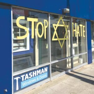 Kenny Tashman, owner of Tashman Home Center in West Hollywood, expressed his feelings after the mass shooting in Pittsburgh with a message on the front windows of his store. (photo by Kenny Tashman)