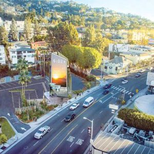 The Sunset Spectacular billboard tower will stand 64 feet high and display arts programming by the Museum of Contemporary Art, in addition to digital advertising, on its three petal-like facades. (rendering courtesy of the city of West Hollywood)