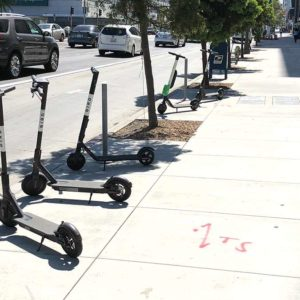 Beverly Hills and other cities have been trying to come up with solutions to address the public safety concerns posed by electric scooters. (photo by Luke Harold)