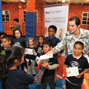 Jake T. Austin presented gift cards from CHA Hollywood Presbyterian to kids at the Boys & Girls Club of Hollywood. (photo by Jay Kim, The Korea Daily)
