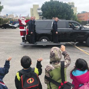 Santa arrived at Selma Avenue Elementary School on the back of a special police SUV during the LAPD's Metropolitan Division's toy giveaway on Dec. 14. (photo courtesy of the LAPD's Metropolitan Division)