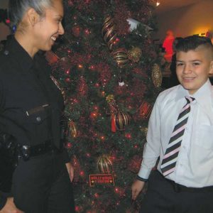 LAPD Hollywood Division officer Zandy Terrones congratulated Andrew Gamboa, 10, on being one of the winners of a scholarship contest for participants in the police station's youth programs. (photo by Edwin Folven)