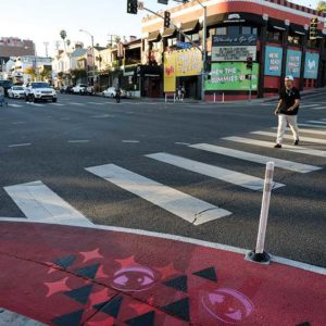 Using extended sidewalks, colorful light poles, signage detailing historical facts about Sunset Boulevard and a screened parklet in front of Book Soup, The Sunset Experience pilot project looks to make the famed boulevard more people-oriented. (photo courtesy of city of West Hollywood)