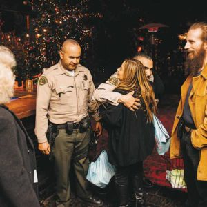 West Hollywood city officials and sheriff's deputies distributed coasters with reminders about not driving impaired to restaurants and bars throughout the city. (photo by Jonathan Moore)