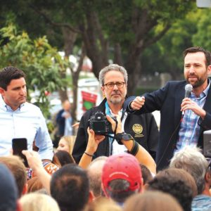 State Assemblyman Jesse Gabriel, Assemblyman Richard Bloom and Sen. Ben Allen joined a protest in Westwood over Trump immigration policy. The three were also behind several laws that will go into effect in 2019. (photo by Luke Harold)