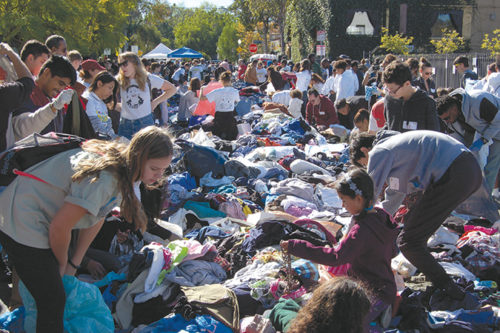 Volunteers sorted a large mound of clothing and prepared it for distribution during Big Sunday's annual Dr. Martin Luther King Jr. Day event. (photo by Edwin Folven)