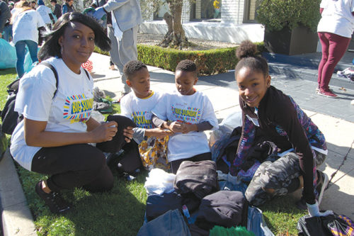 Baldwin Hills resident Chita Oje volunteered with her children Ezeh, Anthony and Eden to teach them about Dr. Martin Luther King Jr.'s legacy. (photo by Edwin Folven)