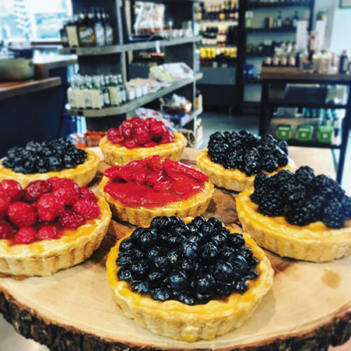 Whether you stop in to enjoy a nice lunch, the lively bar, or a café au lait and fruit tart, Le Petit Marché is a wonderful French café near Larchmont Village. (photo courtesy of Le Petit Marché)